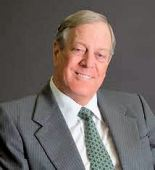 Why is David Koch smiling?