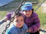 Sahir Salman Abu Namous, 4, (on left) with sibling