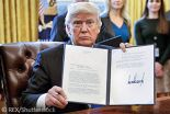 Mandatory Credit: Photo by REX/Shutterstock (8012049a) US President Donald Trump displays one of five executive orders he signed related to the oil pipeline industry in the oval office of the White House in Washington, DC, USA, 24. President Trump has a full day of meetings including one with Senate Majority Leader Mitch McConnell and another with the full Senate leadership. US President Donald Trump signs executive orders on oil pipelines, Washington DC, USA - 24 Jan 2017
